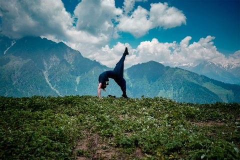A young woman doing yoga exercises in a natural environment